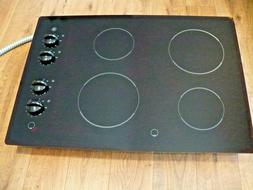 G.E. GLASS STOVE TOP, 4-BURNERS, BRAND NEW, NEVER USED. EXCE