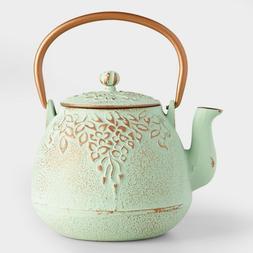 light green embossed cast iron teapot interior
